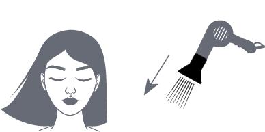 Haare-Extensions in Wuchsrichtung föhnen